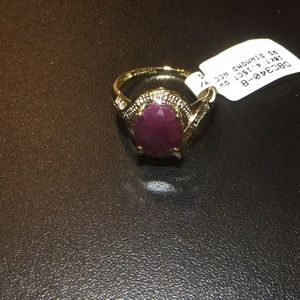 10K  4.15CT oval ruby w/round diamond accents